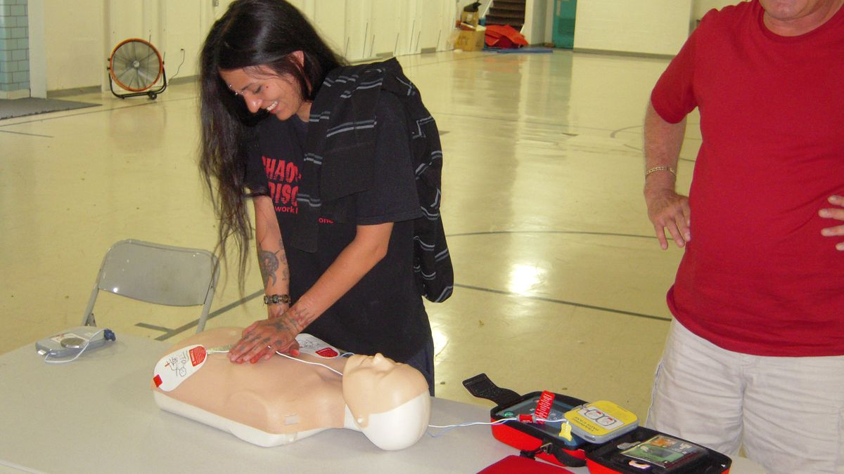 Chantelle Sena, receptionist at the Denver Indian Center, learns from Heart Smart's Rich Perse how to perform chest compressions as part of the efforts to restart a heart. The center recently received an AED with help from the Kick Start My Heart Foundation.