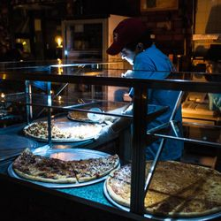 """East Village Pizza churned out pizzas during the blackout [Photo: <a href=""""http://www.flickr.com/photos/zokuga/8142147586/in/set-72157631897206139/"""">Dan Nguyen @ New York City</a>]"""