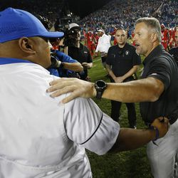Utah Utes head coach Kyle Whittingham and Brigham Young Cougars head coach Kalani Sitake greet after the game in Provo on Saturday, Sept. 9, 2017. Utah won 19-13.