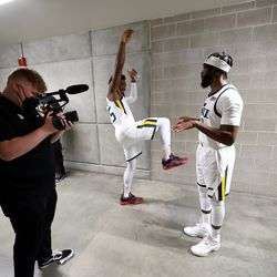Utah Jazz guard Donovan Mitchell (45) and Jazz guard Mike Conley (11) talk in the hallway after being interviewedduring the Utah Jazz media media day at Vivint Arena in Salt Lake City on Monday, Sept. 27, 2021.