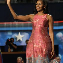 First Lady Michelle Obama waves to delegates at the Democratic National Convention in Charlotte, N.C., on Monday, Sept. 3, 2012.