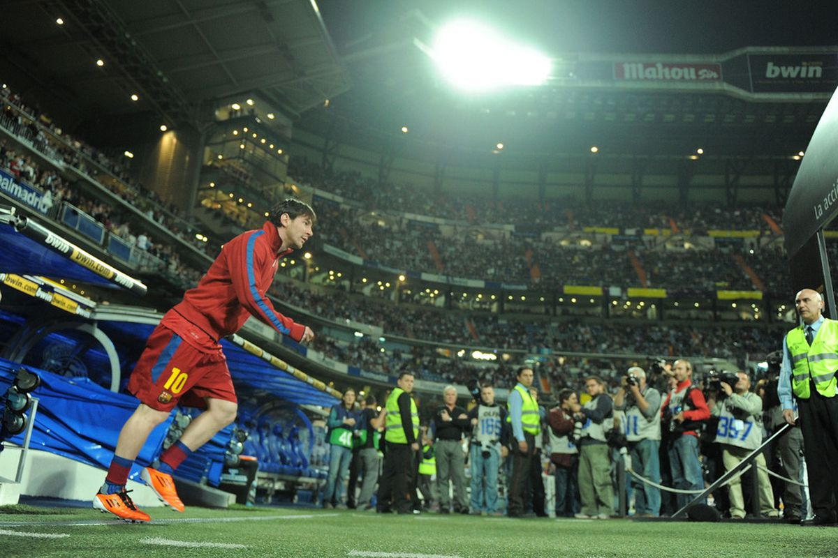 MADRID, SPAIN - APRIL 16:  Lionel Messi of Barcelona takes to the field before the start of  the La Liga match between Real Madrid and Barcelona at Estadio Santiago Bernabeu on April 16, 2011 in Madrid, Spain.  (Photo by Denis Doyle/Getty Images)