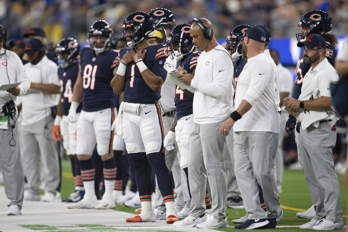 Bears quarterback Justin Fields (1) watches his team playing against the Los Angeles Rams in Inglewood, Calif.