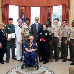 President Barack Obama greets representatives from the Boy Scouts of America to receive their Report to the Nation and an honorary membership card, in the Oval Office, March 1, 2016.