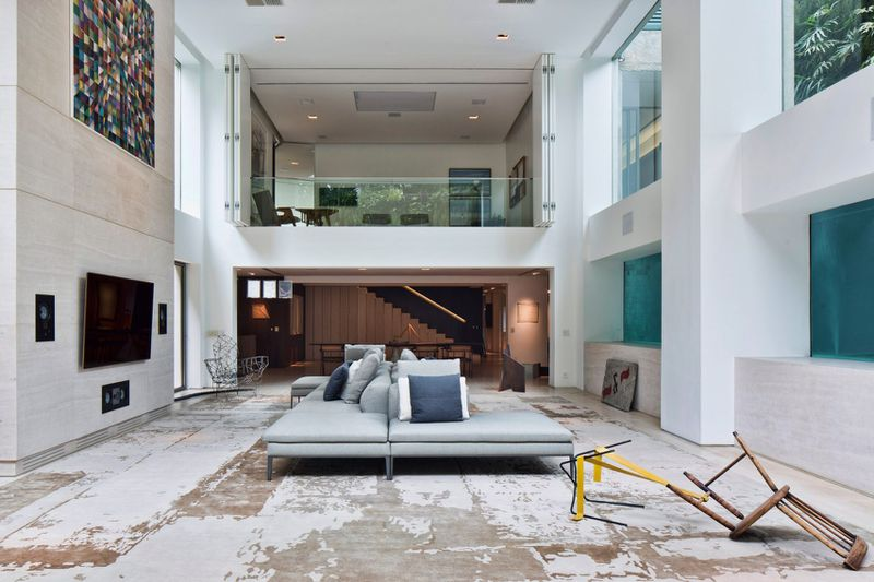 Dramatic apartment renovation puts glass pool center stage