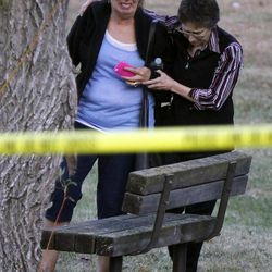 An unidentified woman is consoled at the scene of  a shooting that left at least two dead and four others wounded at Accent Signage Systems in Minneapolis, Thursday, Sept. 27, 2012.