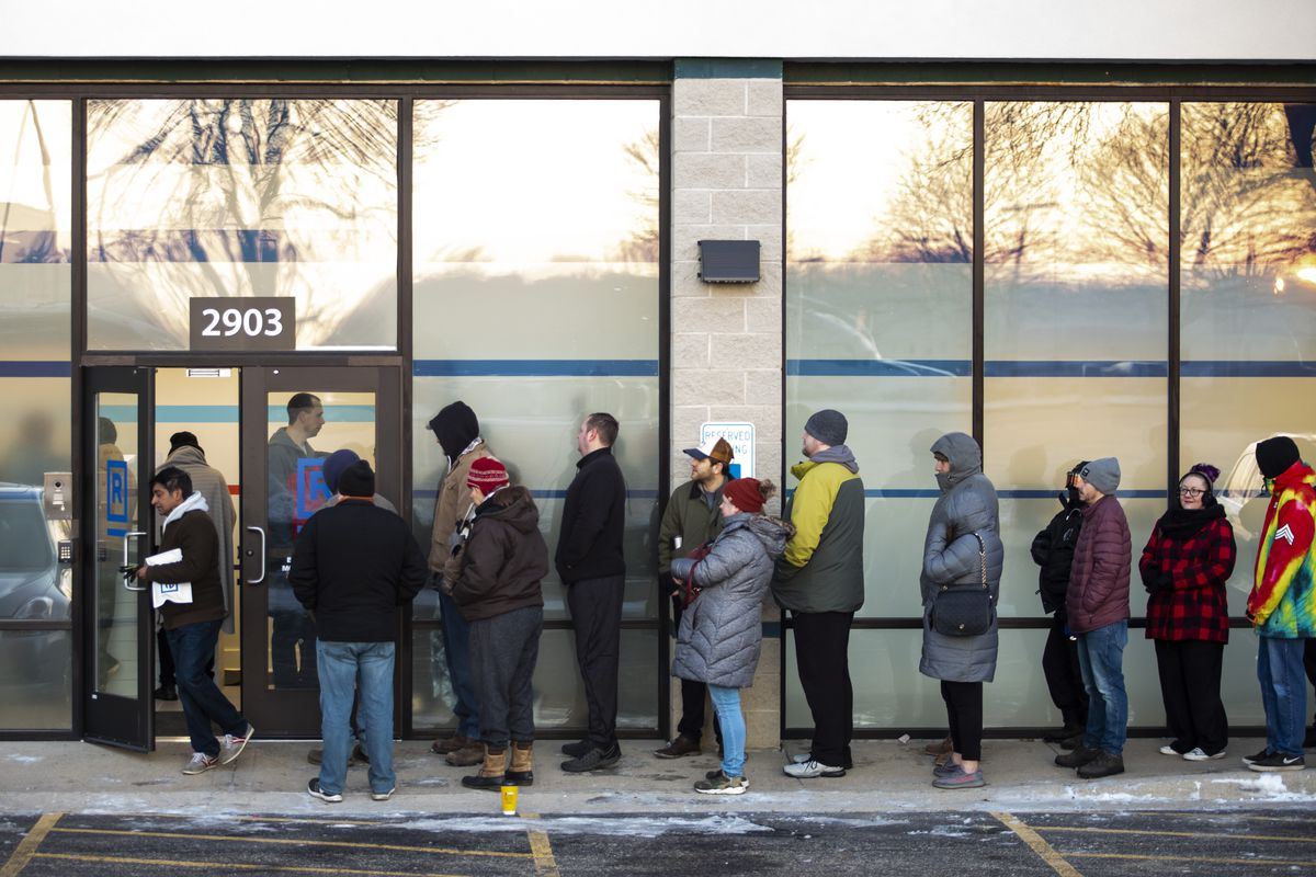Hundreds of customers stand in line at Rise Joliet, a cannabis dispensary in southwest suburban Joliet