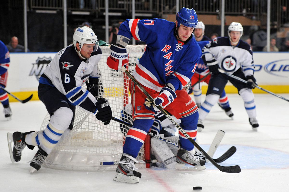 NEW YORK, NY - JANUARY 24: Brandon Dubinsky #17 of the New York Rangers controls the puck during the second period against the Winnipeg Jets on January 24, 2012 at Madison Square Garden in New York City. (Photo by Christopher Pasatieri/Getty Images)
