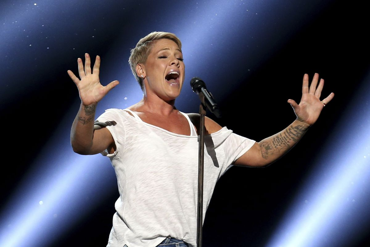 """In this Jan. 28, 2018, file photo, Pink performs """"Wild Hearts Can't Be Broken"""" at the 60th annual Grammy Awards at Madison Square Garden in New York."""