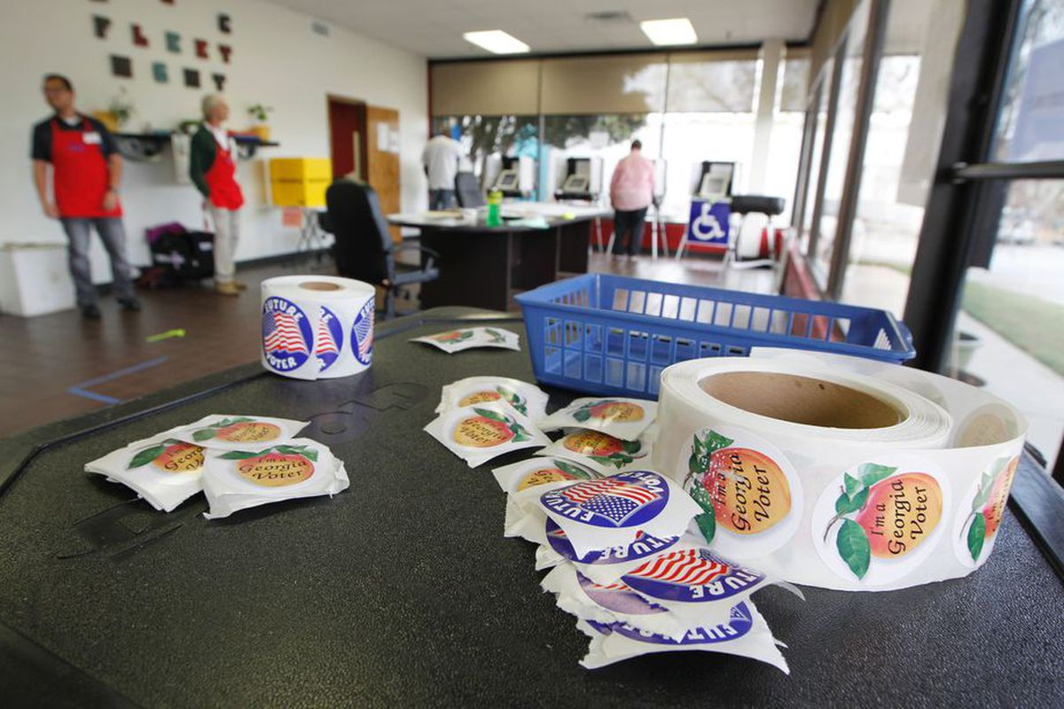 Familiar peach stickers were distributed in record numbers Tuesday.