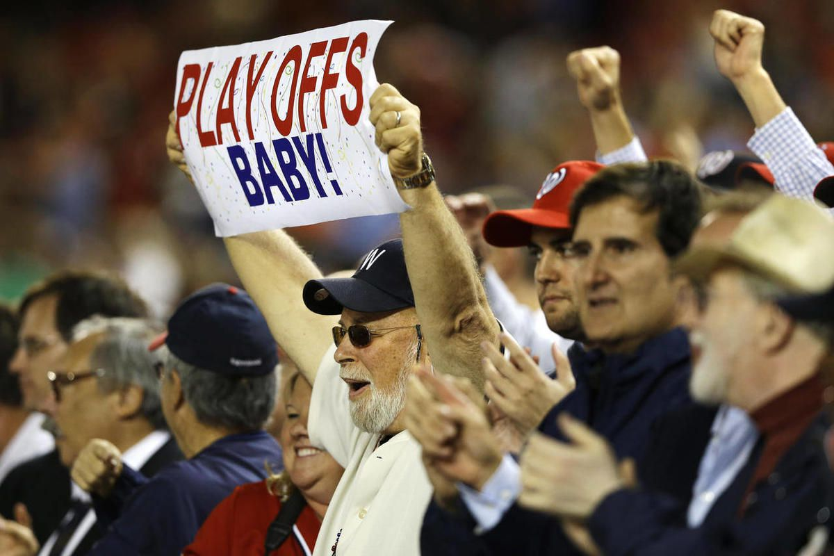 Fans celebrate the Washington Nationals as they clinched a playoff spot Thursday night with a 4-1 win over the Los Angeles Dodgers in a baseball game at Nationals Park, in Washington, on Thursday, Sept. 20, 2012.