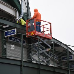 Another view, workers in the bleachers