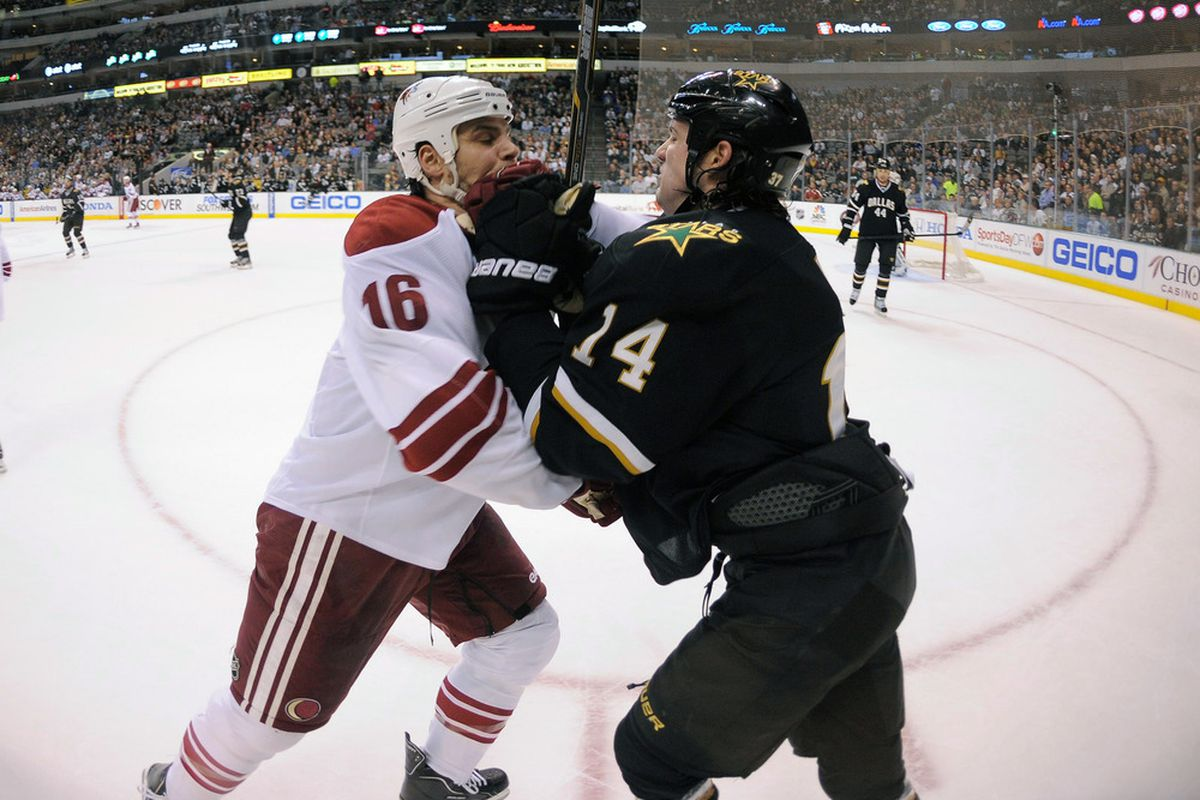 Mar 20, 2012; Dallas, TX, USA;  Phoenix Coyotes defenseman Rostislav Klesla (16) and Dallas Stars left wing Jamie Benn (14) fight for position during the first period at the American Airlines Center. Mandatory Credit: Jerome Miron-US PRESSWIRE