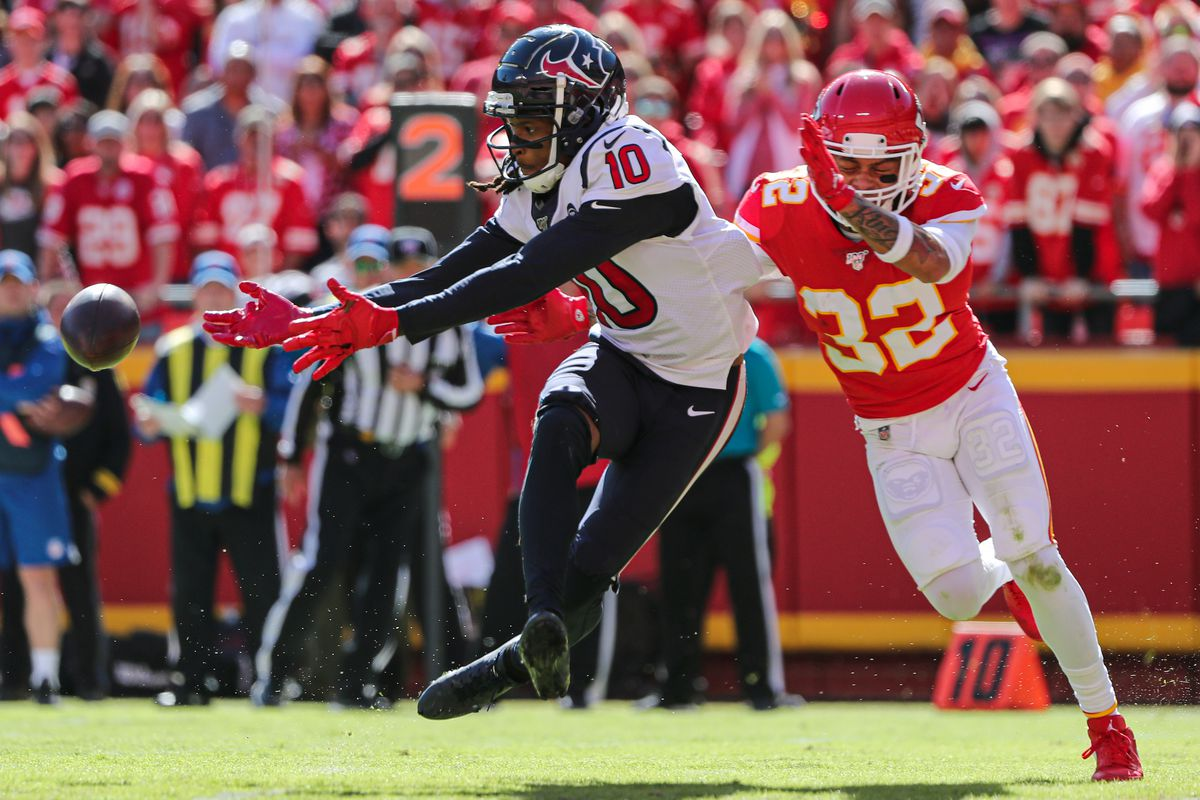 Houston Texans wide receiver DeAndre Hopkins is unable to make the catch as Kansas City Chiefs strong safety Tyrann Mathieu defends during the second half at Arrowhead Stadium.
