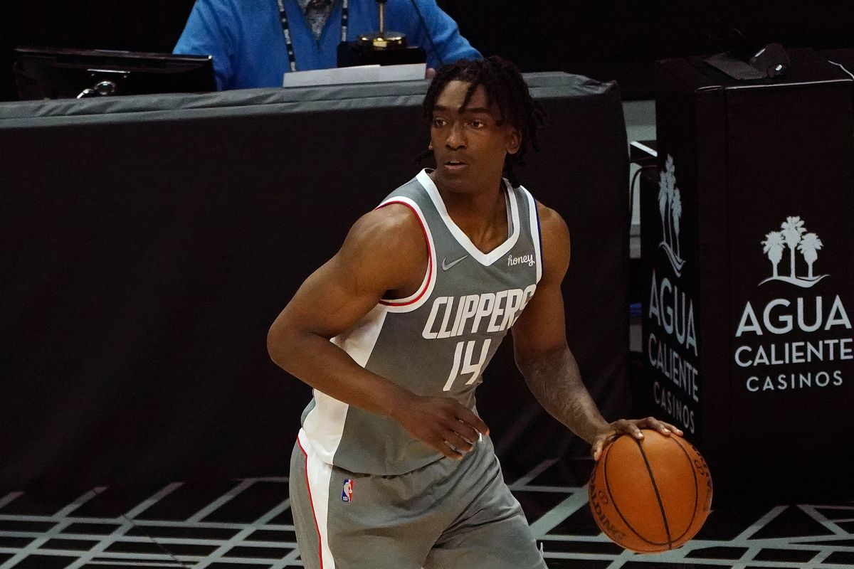Los Angeles Clippers guard Terance Mann controls the ball against the Milwaukee Bucks during the second half at Staples Center.