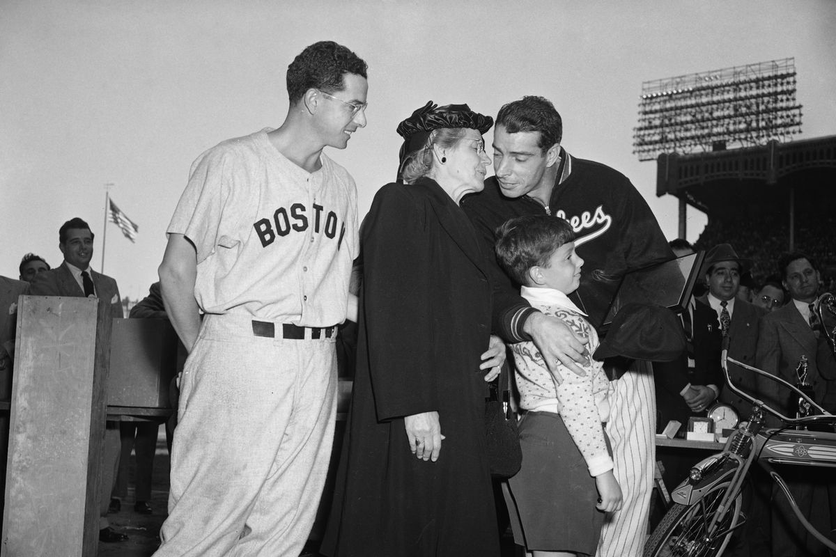 Joe Dimaggio Standing With His Family.