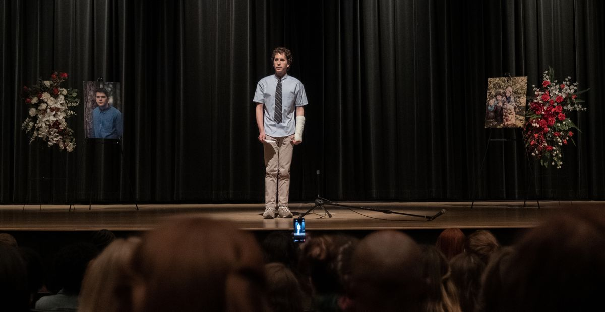 Evan stands on stage at a memorial for Connor in Dear Evan Hansen