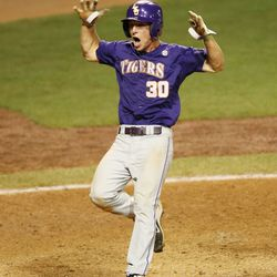 LSU Tigers infielder Alex Bregman (30) reacts after crossing home plate to score the tying run against Sam Houston State in the Baton Rouge regional of the   2013 NCAA baseball tournament.