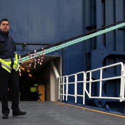 A ferry worker, acting as a watchman, part of a skeleton crew remains on duty, during a 48-hours strike at the port of Piraeus, near Athens, on Tuesday, April 10, 2012. Ferry services to Greek islands have been halted by a 48-hour strike that is expected to hit the start of the country's tourism season and celebrations for Orthodox Easter this Sunday.