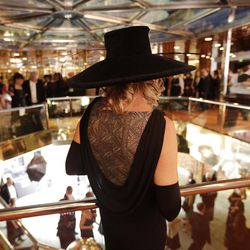 A passenger in evening gown, stands on the main deck of the MS Balmoral Titanic memorial cruise ship, prior to the gala dinner in the Atlantic Ocean, Friday, April 13, 2012. Nearly 100 years after the Titanic went down, the cruise with the same number of passengers aboard is setting sail to retrace the ship's voyage, including a visit to the location where it sank. The Titanic Memorial Cruise departed Sunday, April 8, from Southampton, England, where the Titanic left on its maiden voyage and the 12-night cruise will commemorate the 100th anniversary of the sinking of the White Star liner early Sunday, April 15, 2012. AP Photo/Lefteris Pitarakis)