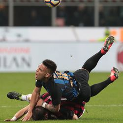 Lautaro Martinez of FC Internazionale competes for the ball with Andrea Conti of AC Milan during the Serie A match between AC Milan and FC Internazionale at Stadio Giuseppe Meazza on March 17, 2019 in Milan, Italy.
