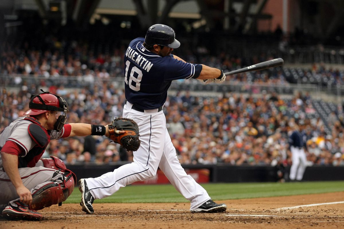 SAN DIEGO, CA - JUNE 2:  Carlos Quentin #18 of the San Diego Padres hits a single against the Arizona Diamondbacks during their MLB Baseball Game on June 2, 2012 at Petco Park in San Diego, California. (Photo by Donald Miralle/Getty Images)