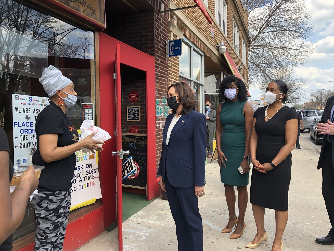 Vice President Kamala Harris speaks to an employee at Brown Sugar Bakery during her visit to Chicago on Tuesday, April 6, 2021. Cook County State's Attorney Kim Foxx and Lt. Gov. Juliana Stratton look on.