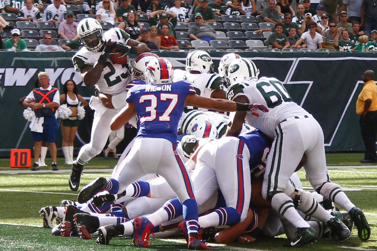 Sept. 9, 2012; East Rutherford, NJ, USA; New York Jets running back Shonn Greene (23) goes over the top for a touchdown during the fourth quarter against the Buffalo Bills at MetLife Stadium. Jets won 48-28. Mandatory Credit: Debby Wong-US PRESSWIRE