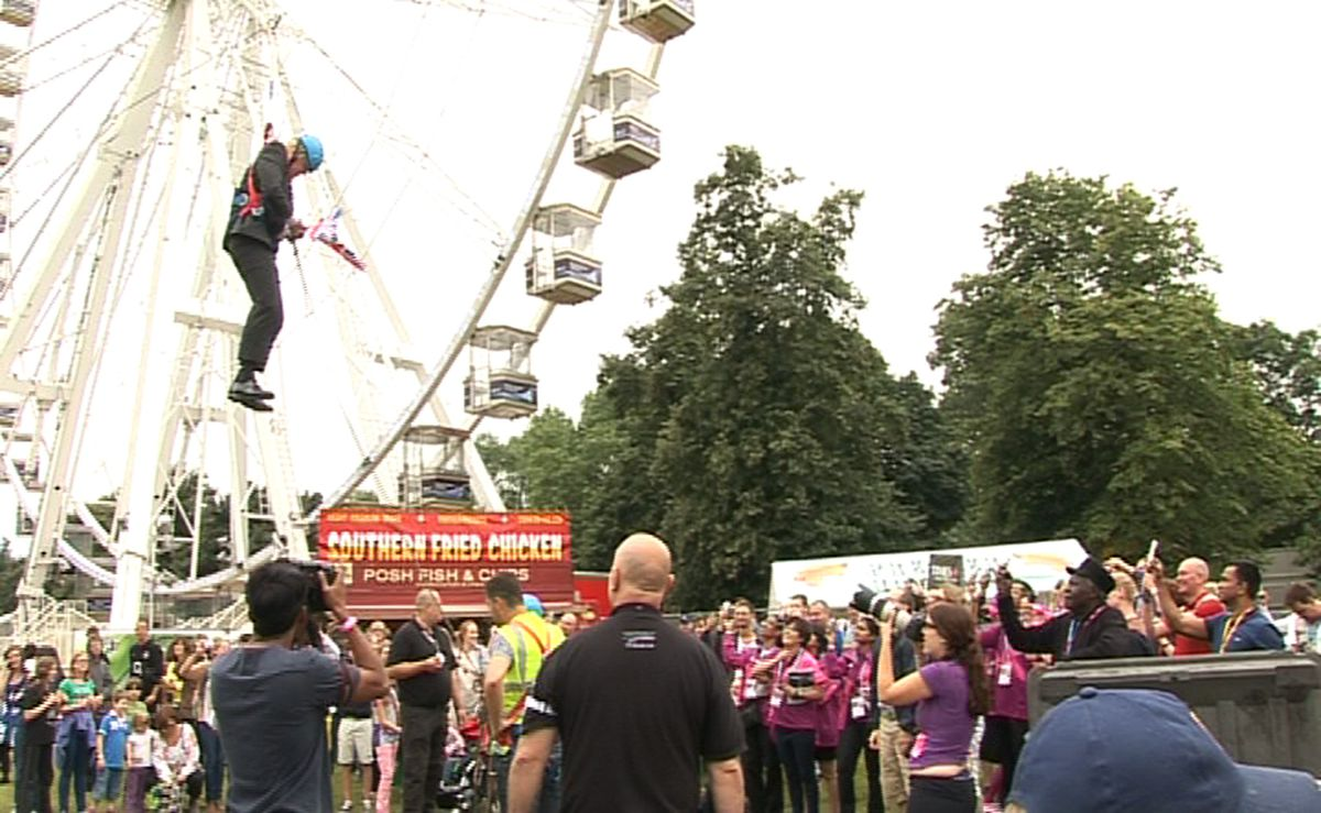 Then-London Mayor Boris Johnson inserting in midair after he bought stuck on a zipwire at an Olympic occasion at Victoria Park in London on January eight, 2012.