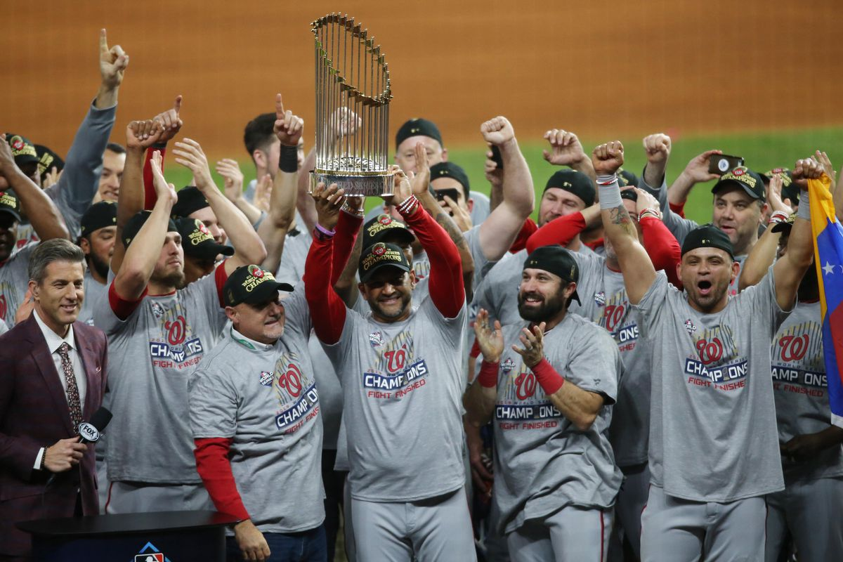 Washington Nationals manager Dave Martinez and general manager Mike Rizzo hoist the Commissioners Trophy after defeating the Houston Astros in game seven of the 2019 World Series at Minute Maid Park.