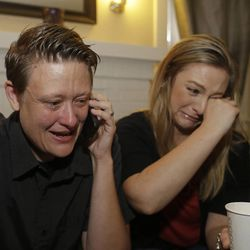 Same sex couple Lisa Kirk, left, and Lena Brancatelli, right, cry while reacting to the U.S. Supreme Court's ruling on gay marriage in California, Wednesday, June 26, 2013 at their home in San Jose, Calif.  The justices issued two 5-4 rulings in their final session of the term. One decision wiped away part of a federal anti-gay marriage law that has kept legally married same-sex couples from receiving tax, health and pension benefits. The other was a technical legal ruling that said nothing at all about same-sex marriage, but left in place a trial court's declaration that California's Proposition 8 is unconstitutional.  (AP Photo/Eric Risberg)