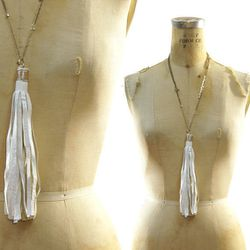 """Earth friendly + statement-making. Leather upcycled tassel necklace, <a href=""""http://www.etsy.com/listing/115137677/leather-fringe-necklace-upcycled-white?ref=v1_other_2"""">$32</a> from Spunk Vintage on Etsy"""
