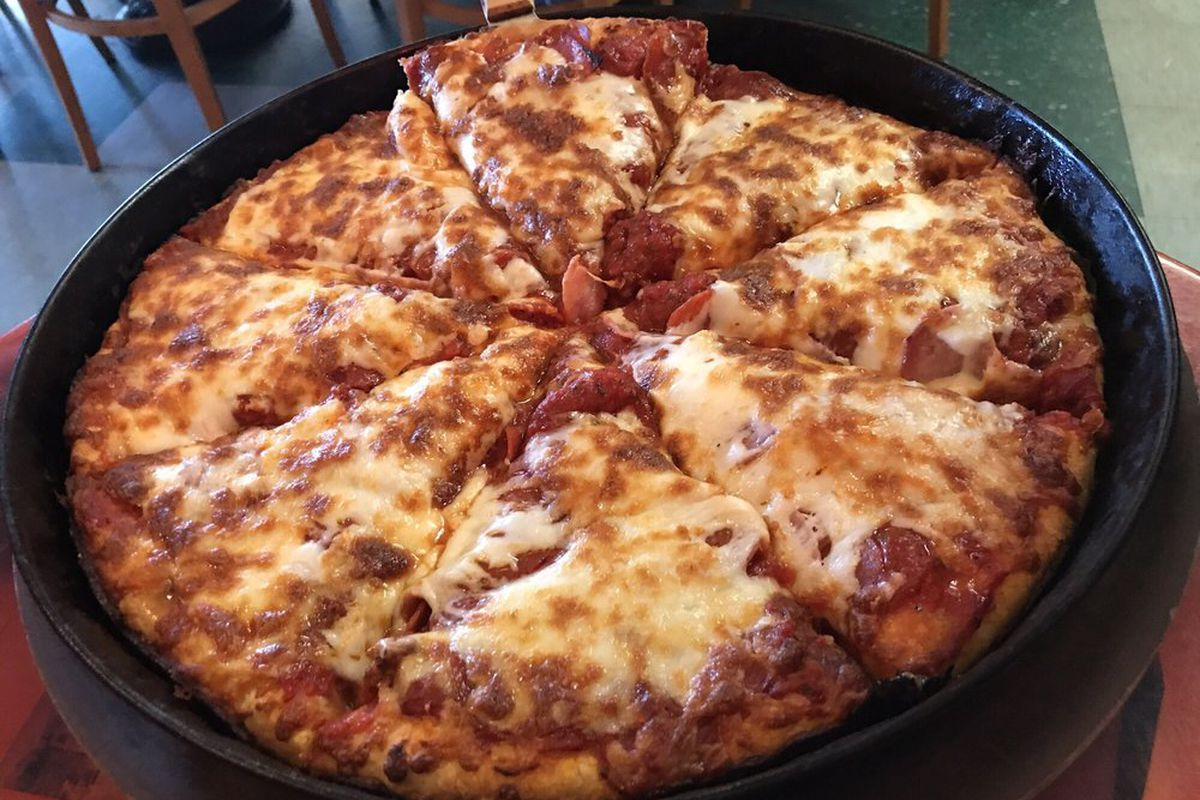 The deep dish meat pizza from Conans