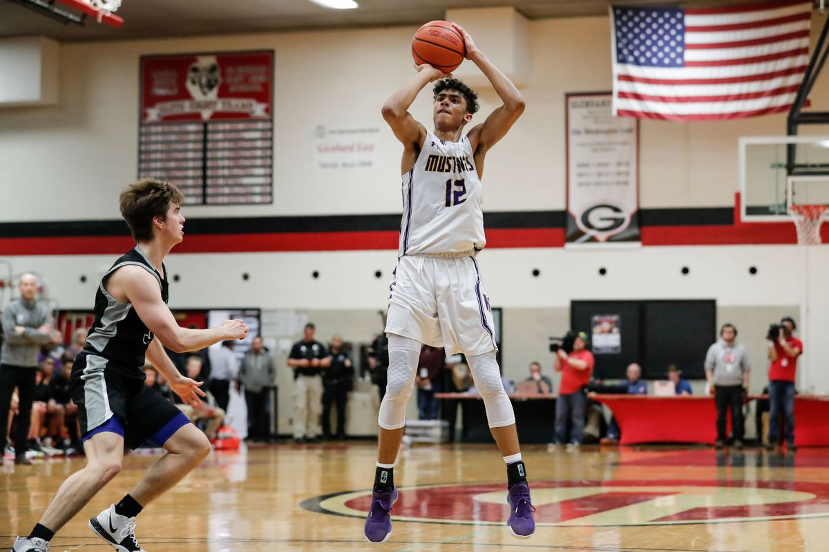 Rolling Meadows' Max Christie (12) shoots the ball against Fenwick.