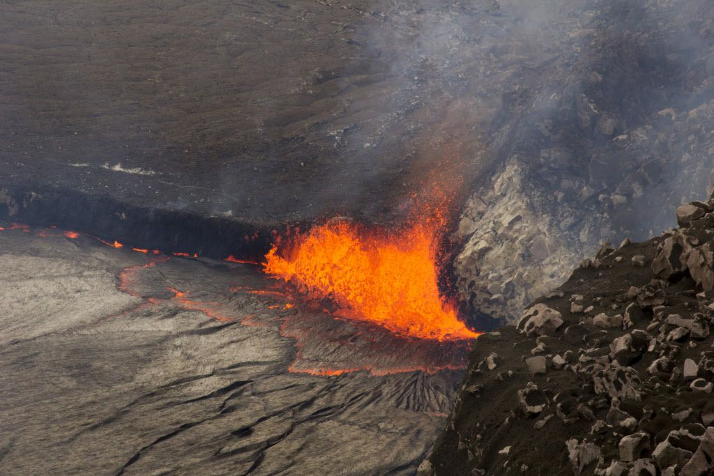 <small><strong>In this April 26, 2015 photo provided by U.S. Geological Survey Hawaiian Volcano Observatory, sparks rise from Kilauea volcano on Hawaii's Big Island.</strong></small>