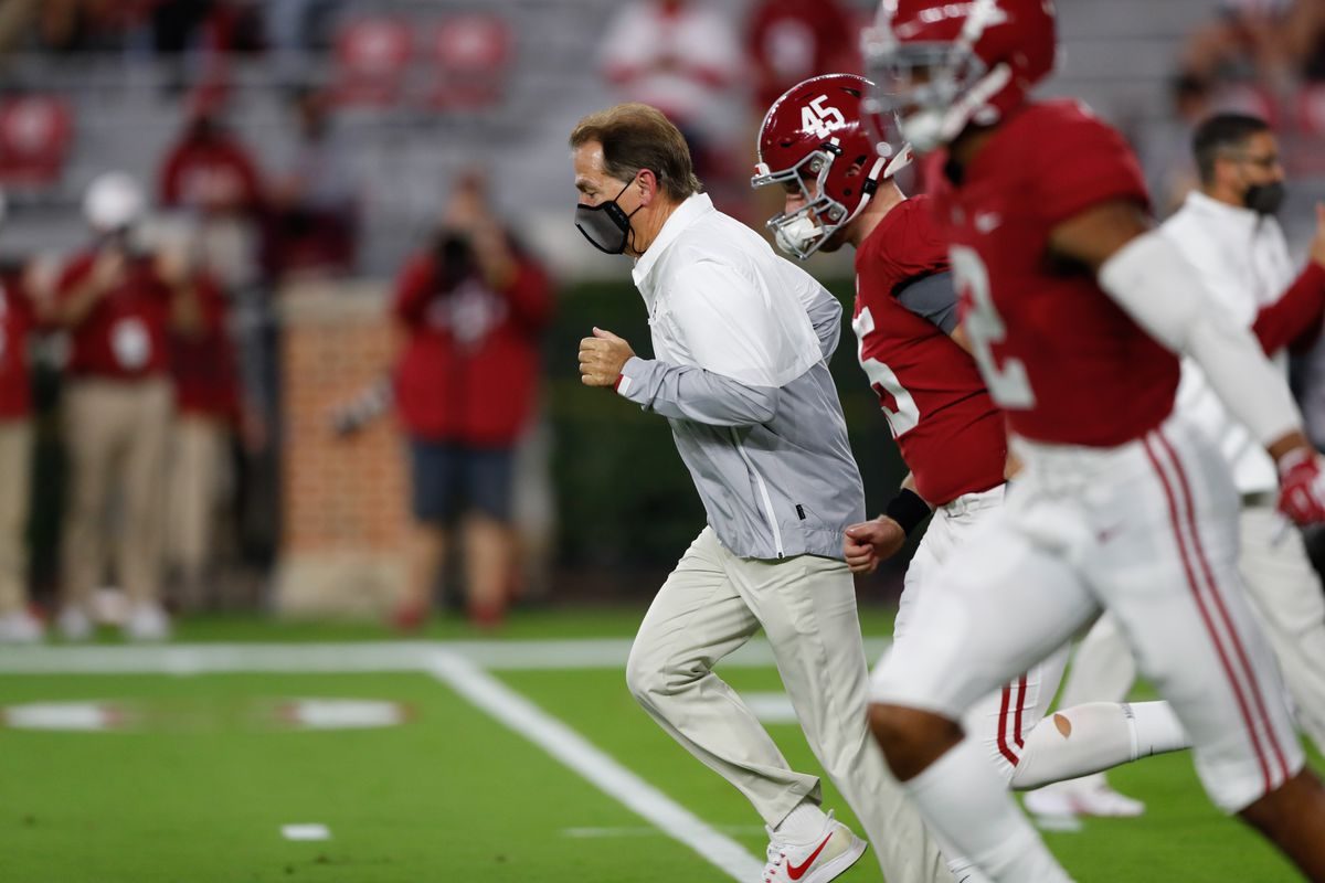 Nick Saban, Head coach of the Alabama Crimson Tide, leads his team into the field prior to the game against the Georgia Bulldogs at Bryant-Denny Stadium on October 17, 2020 in Tuscaloosa, Alabama.