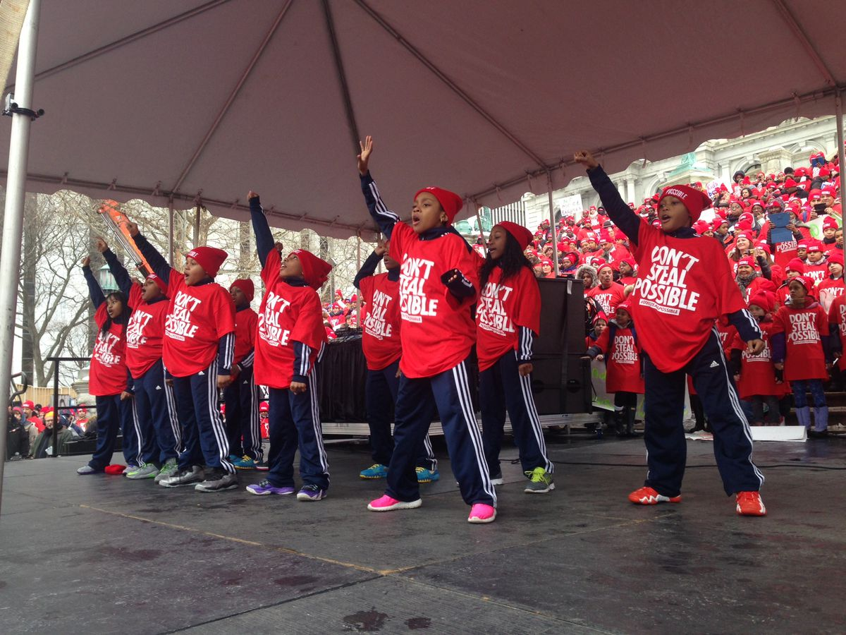 Charter-school students perform at a rally in Albany.