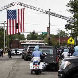 Hundreds of Chicago police officers, other law enforcement officers and mourners pay their respects during the procession to the crematorium after the funeral for Officer Ella French at St. Rita of Cascia Shrine Chapel, Thursday, Aug. 19, 2021. French was fatally shot and her partner was critically wounded while in the line of duty on Aug. 7 in West Englewood.