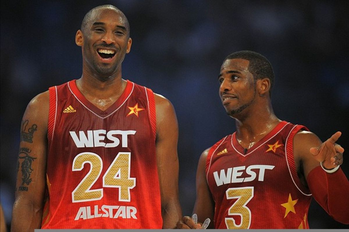 Feb 26, 2012; Orlando, FL, USA; Western Conference guard Kobe Bryant of the Los Angeles Lakers (24) talks to Chris Paul of the Los Angeles Clippers in the 2012 NBA All-Star Game at the Amway Center. Mandatory Credit: Bob Donnan-US PRESSWIRE