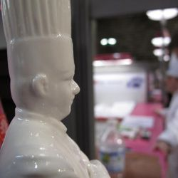 Two chefs: Bocuse (porcelain) and Kaysen (background)