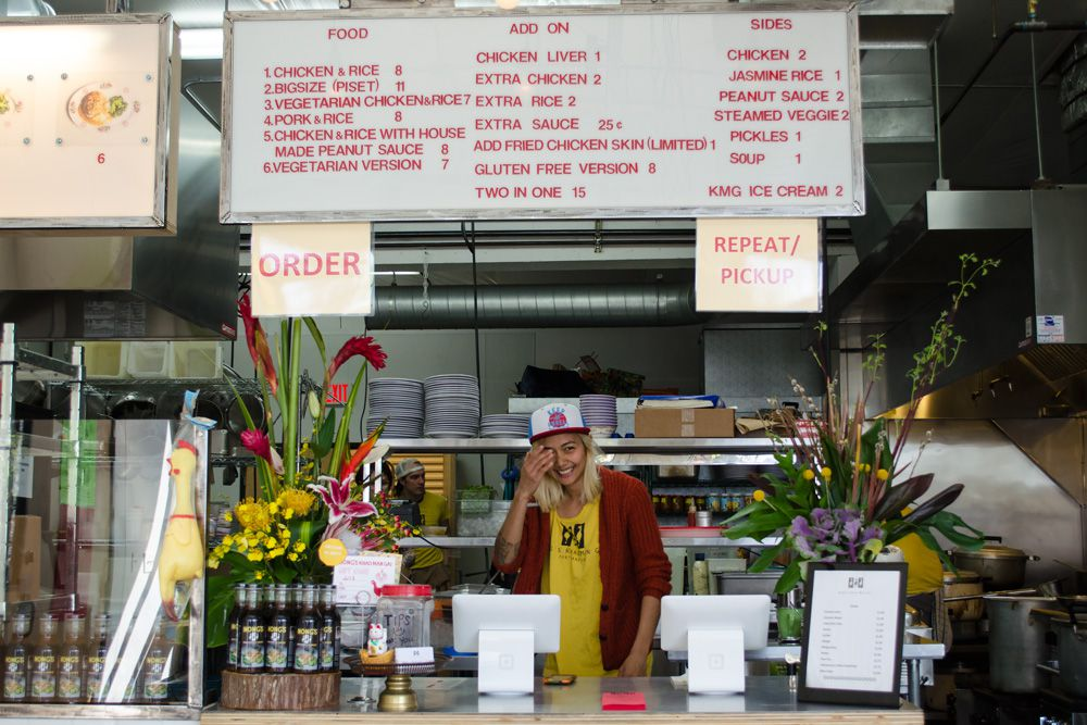 A picture of Nong Poonsukwattana standing at the counter of her restaurant