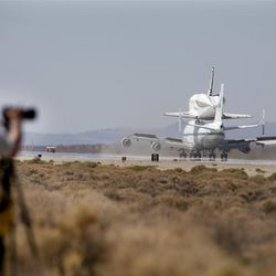 Space Shuttle Endeavour mounted on NASA's Shuttle Carrier Aircraft (SCA) lands at Edwards Air Force Base, Calif., Thursday, Sept. 20, 2012. (AP Photo/Jae C. Hong)