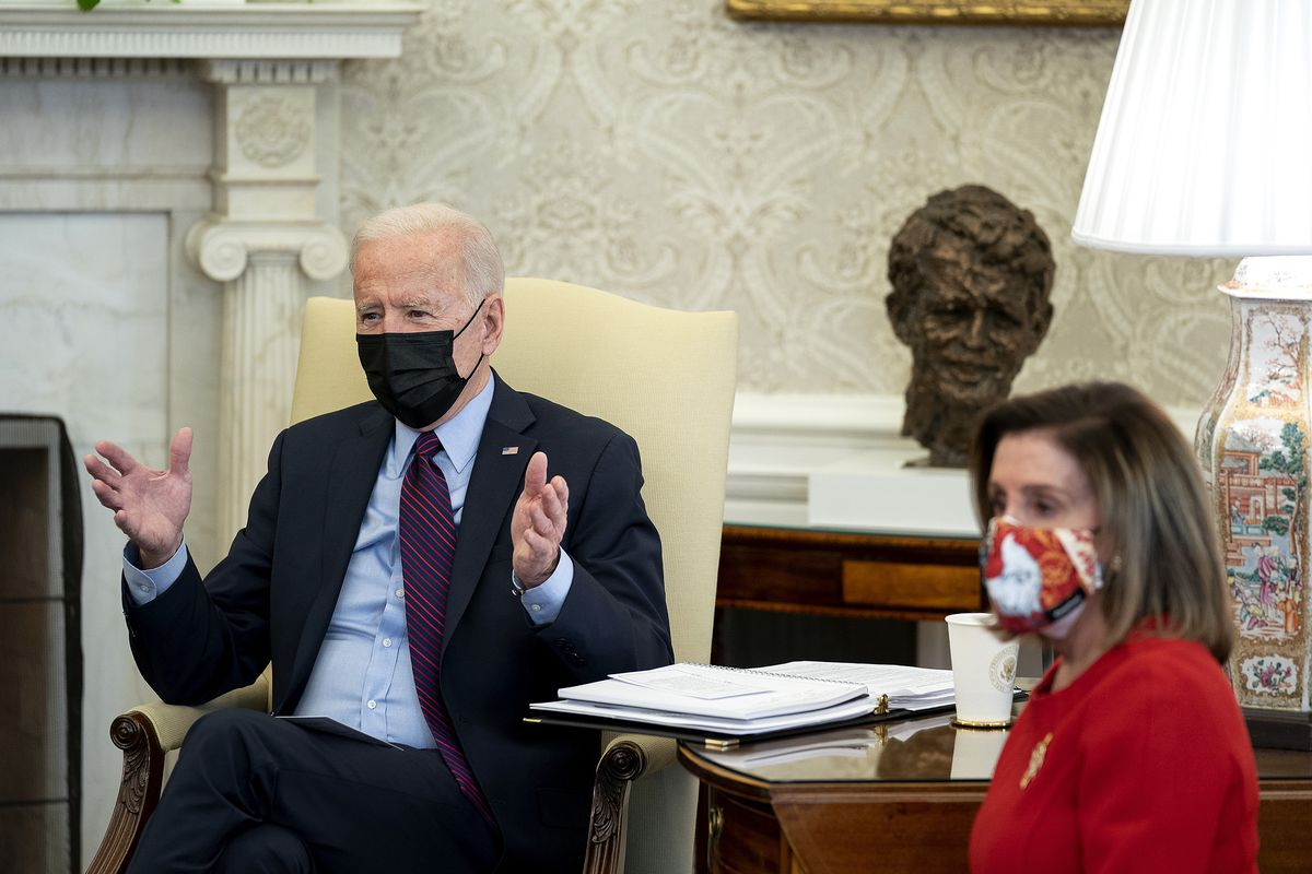 Biden and Pelosi seated speaking in the Oval Office.