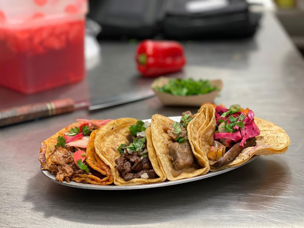 A plate of four tacos.