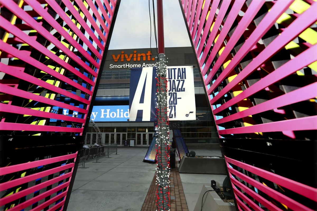 A light display decorates the Vivint Smart Home Arena in Salt Lake City on Friday, Dec. 18, 2020. A unanimous vote by the NBA board of governors approved the Miller family's sale of the nearly 50-year-old franchise to tech entrepreneur Ryan Smith and his wife, Ashley.