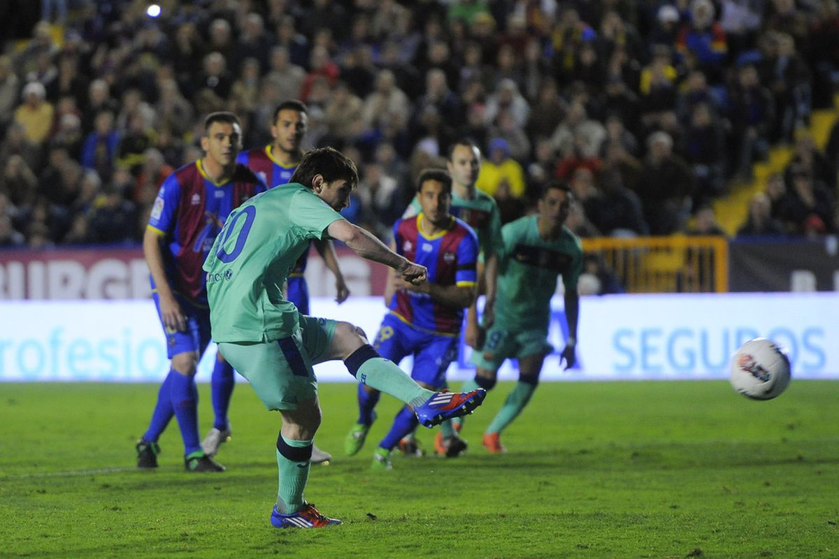 VALENCIA, SPAIN - APRIL 14:  Lionel Messi of FC Barcelona scores his team's second goal from the penalty spot during the La Liga match between Levante UD and FC Barcelona.