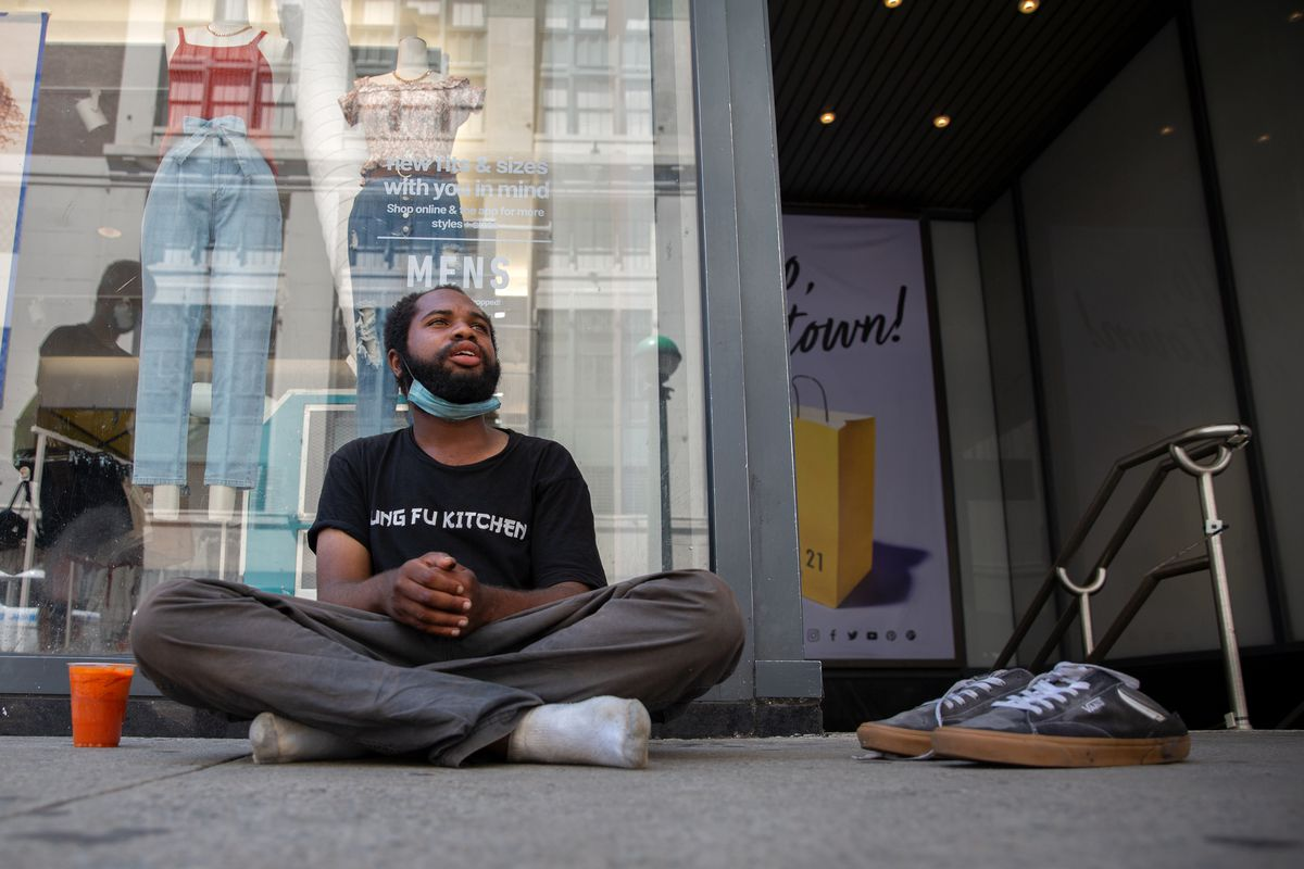 Jarred Mitchell, 24, who is homeless, says he has a medical condition that requires him to drink extra water, Aug. 4, 2020.
