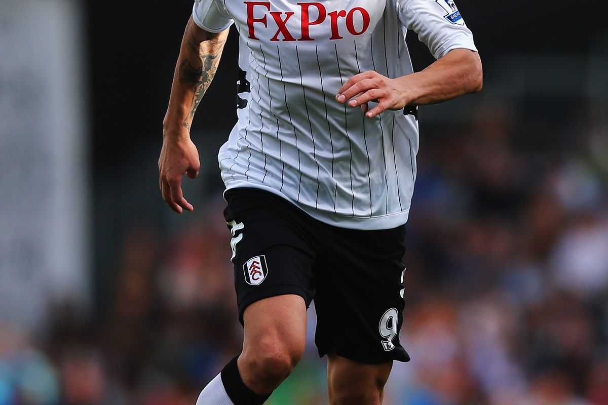 LONDON, ENGLAND - SEPTEMBER 15:  Dimitar Berbatov of Fulham in action during the Barclays Premier League match between Fulham and West Bromwich Albion at Craven Cottage on September 15, 2012 in London, England.  (Photo by Clive Rose/Getty Images)