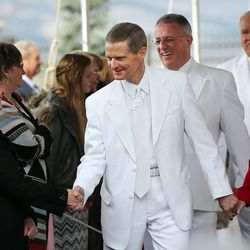 Elder David A. Bednar of the Quorum of the Twelve Apostles greets Sister Barbara D. Perry before the cornerstone ceremony of the Star Valley Wyoming Temple Dedication in Afton, Wyoming, on Sunday, Oct. 30, 2016. At right is Sister Susan K. Bednar.