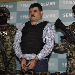 """Mexican Navy marines flank Jorge Eduardo Costilla Sanchez, aka """"El Coss,"""" during his media presentation at the Mexican Navy's Center for Advanced Naval Studies in Mexico City,Thursday, Sept. 13, 2012. Costilla is the alleged leader of the Gulf drug cartel. One of Mexico's most-wanted men, the 41-year-old is charged in the U.S. with drug-trafficking and threatening U.S. law enforcement officials. U.S. authorities offered $5 million for information leading to his arrest."""